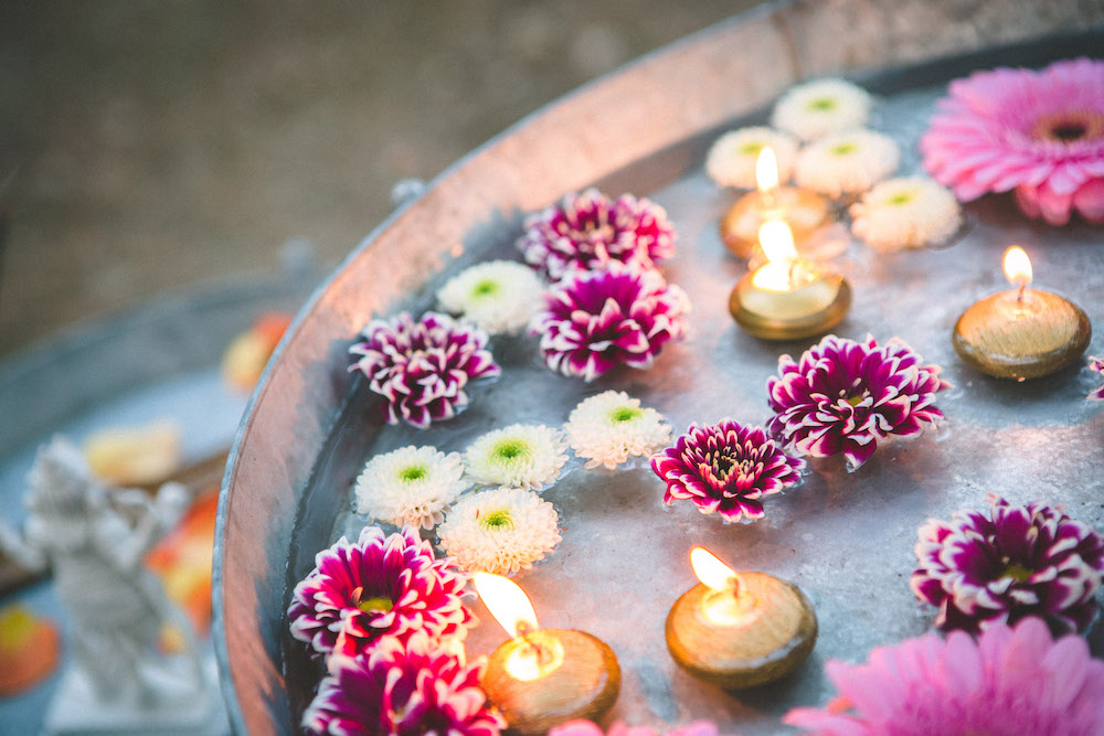 Flowers in water décor at an interfaith wedding ceremony