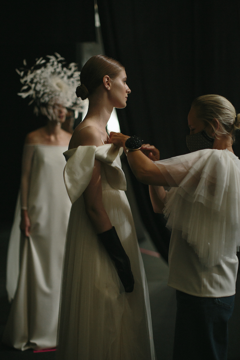 A Sophie et Voilà bridal model preparing for the catwalk at Valmont Barcelona Bridal Fashion Week