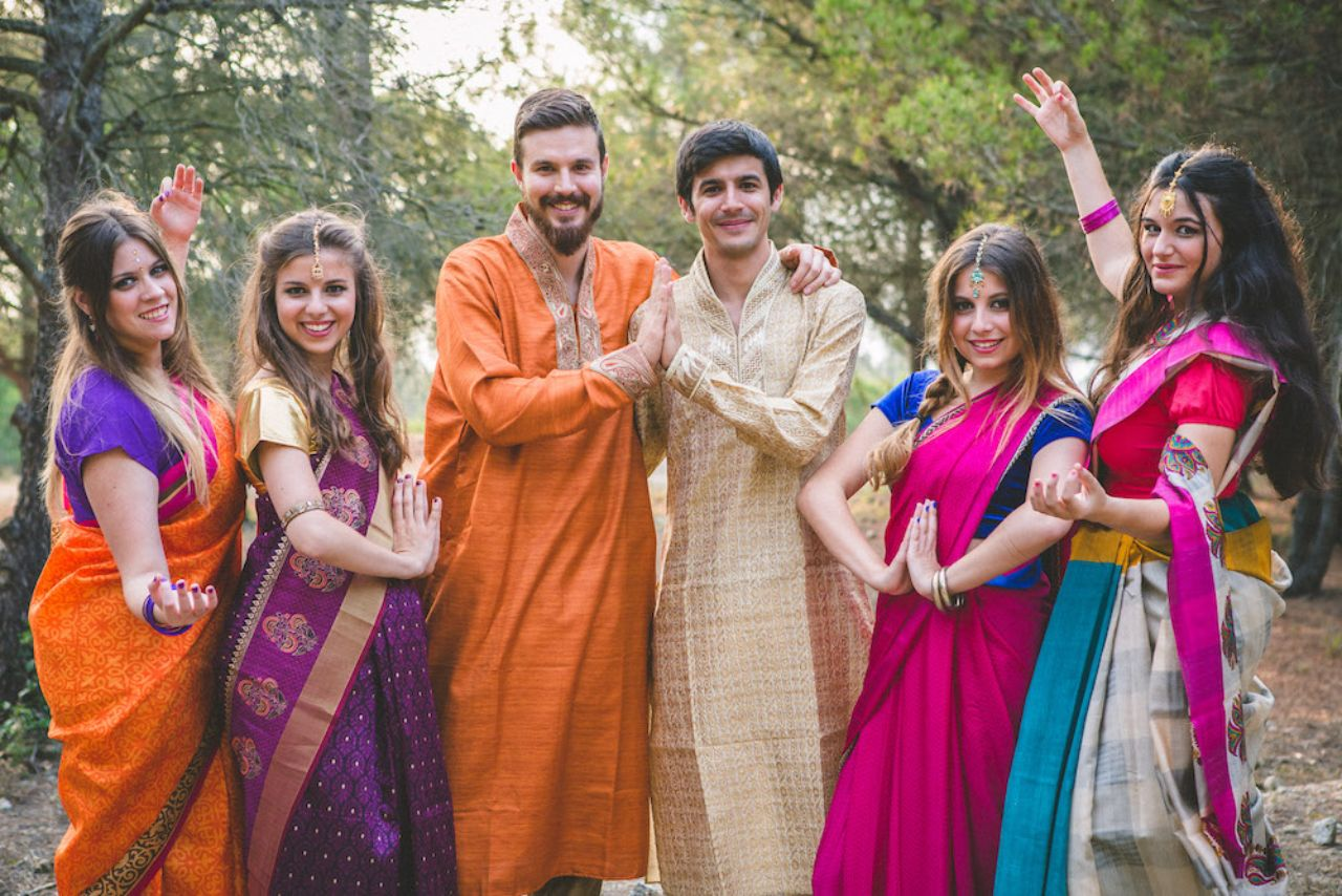 A group of friends together at an interfaith and micro wedding