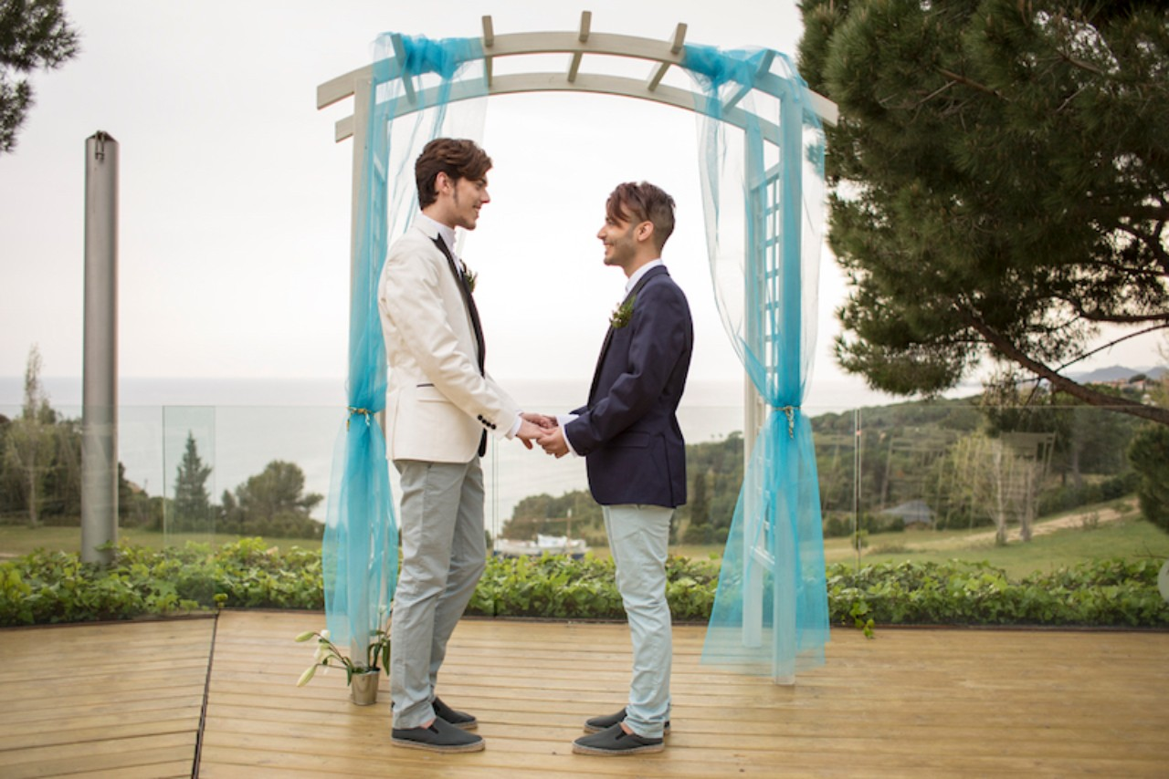 A gay couple saying their wedding vows outside in an intimate wedding