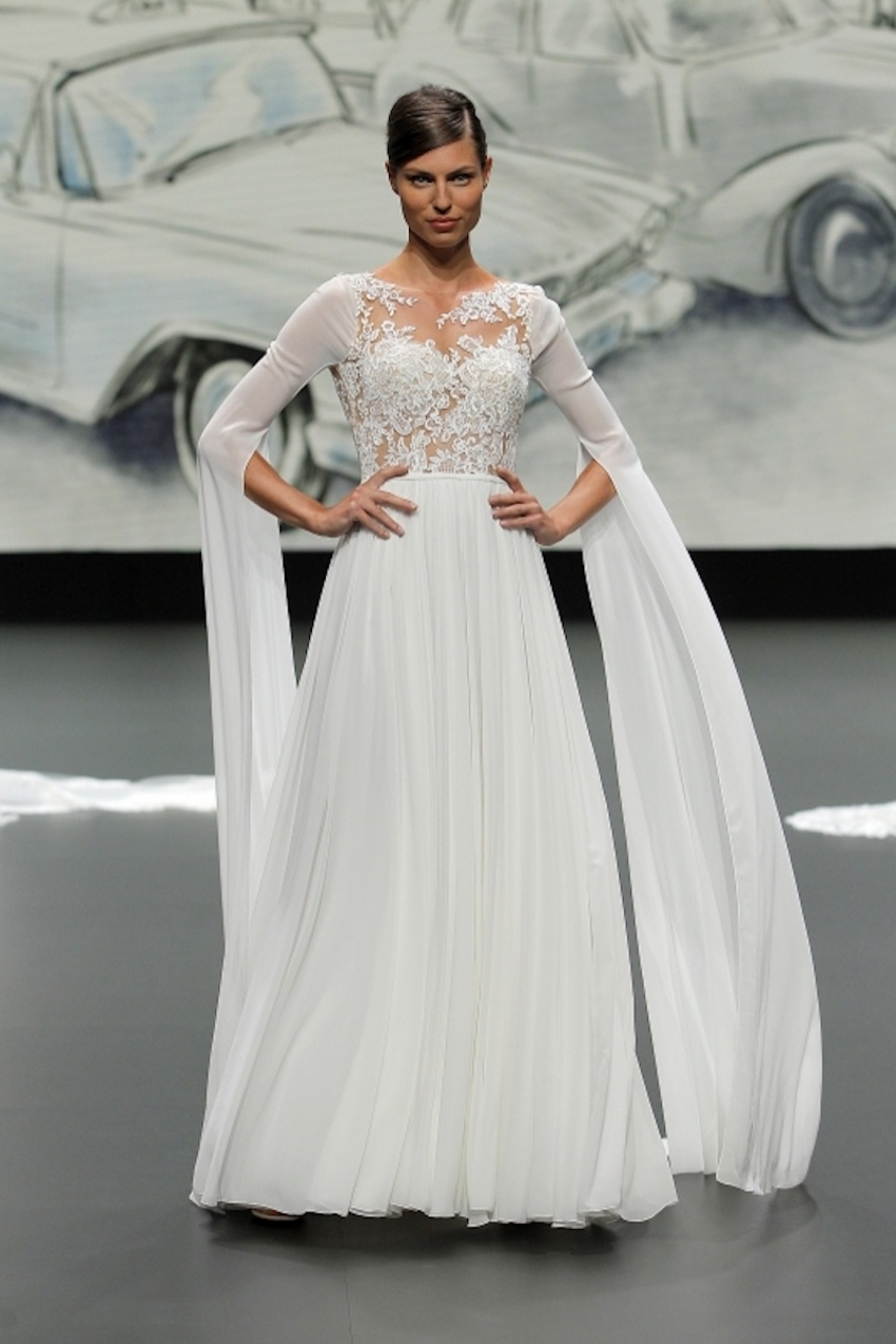 A St Patrick bridal model wearing a long-sleeved, flowing dress