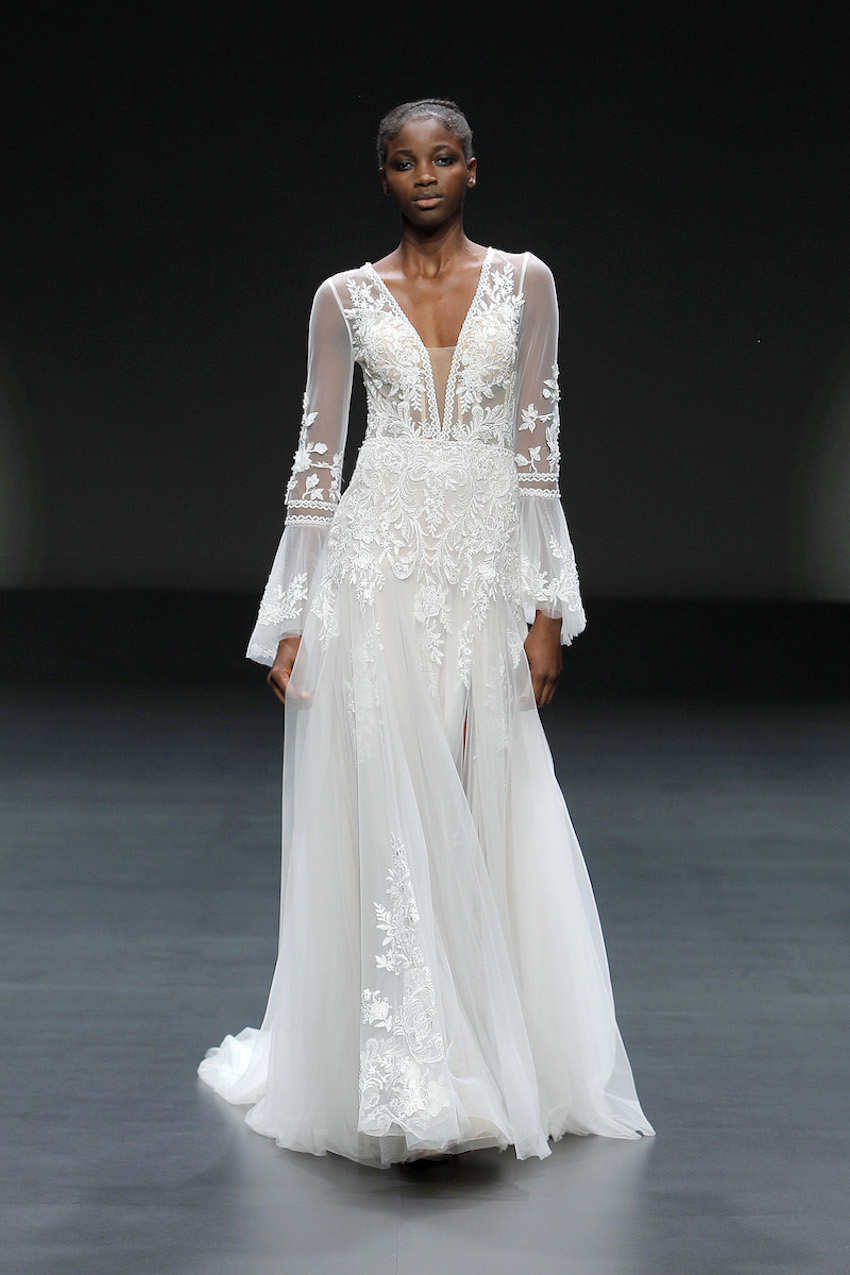 A Pronovias bridal model wearing a flowing embroidered dress