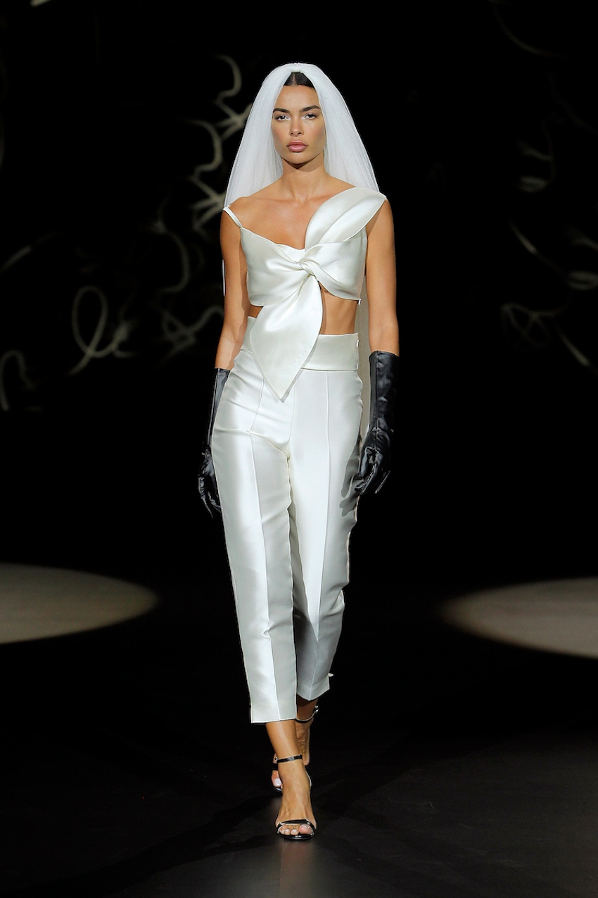 A Sophie et Voilà bridal model wearing trousers and a veil