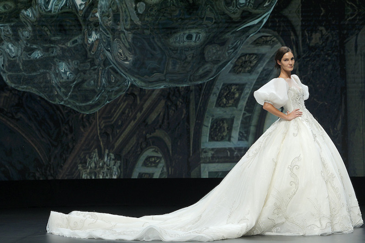 A The Atelier bridal model wearing a puffy-sleeved dress