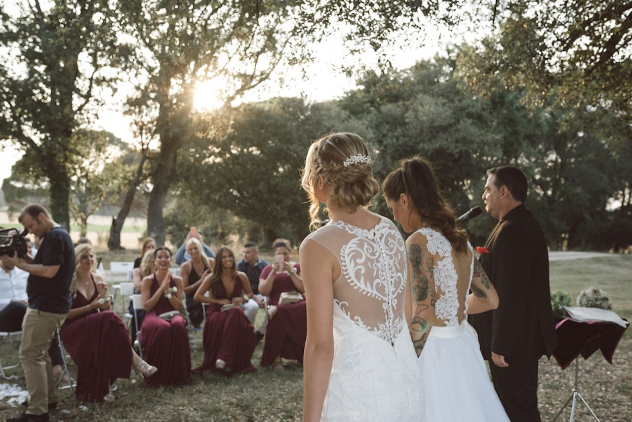 Two lesbian brides on their wedding day in bridal gowns