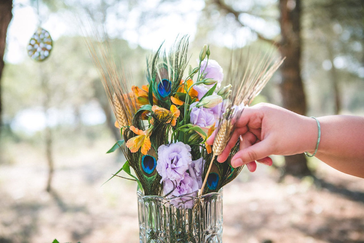 A wedding planner adjusting beautiful wedding flowers
