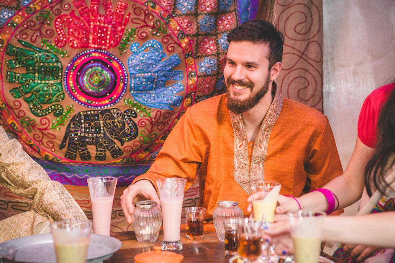 A groom at an interfaith wedding party