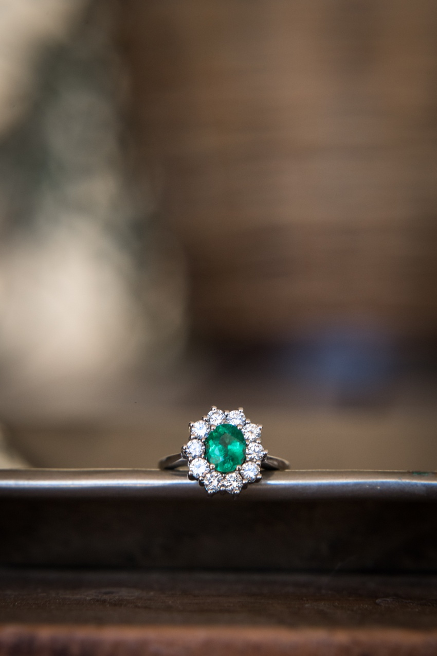 An emerald and diamond engagement ring