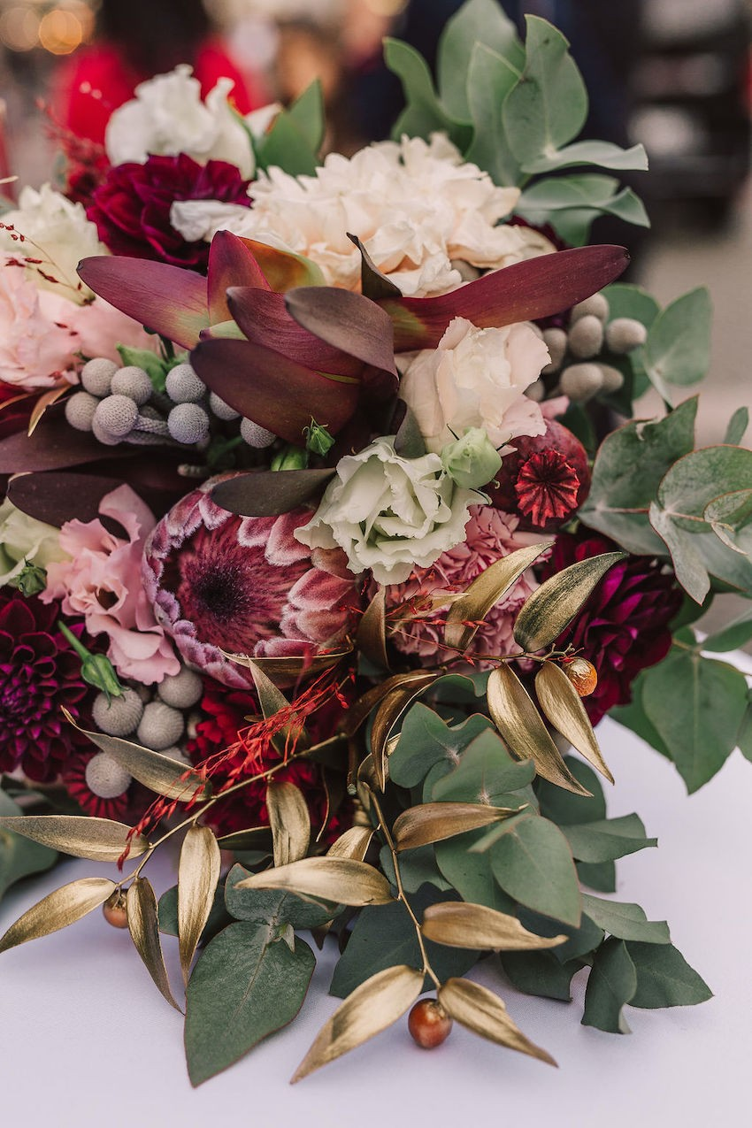 A beautiful bouquet of red and pink wedding flowers