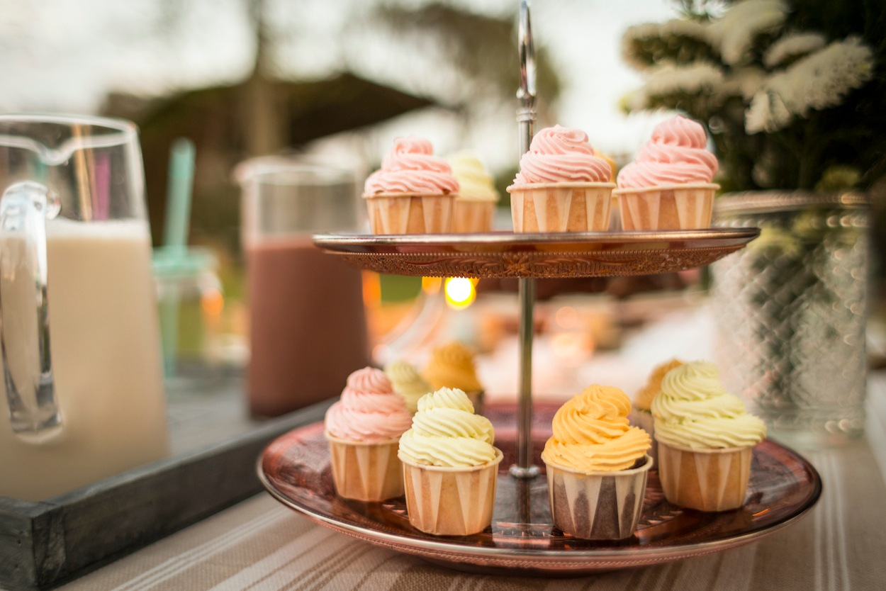 A stack of delicious wedding cupcakes at a wedding reception