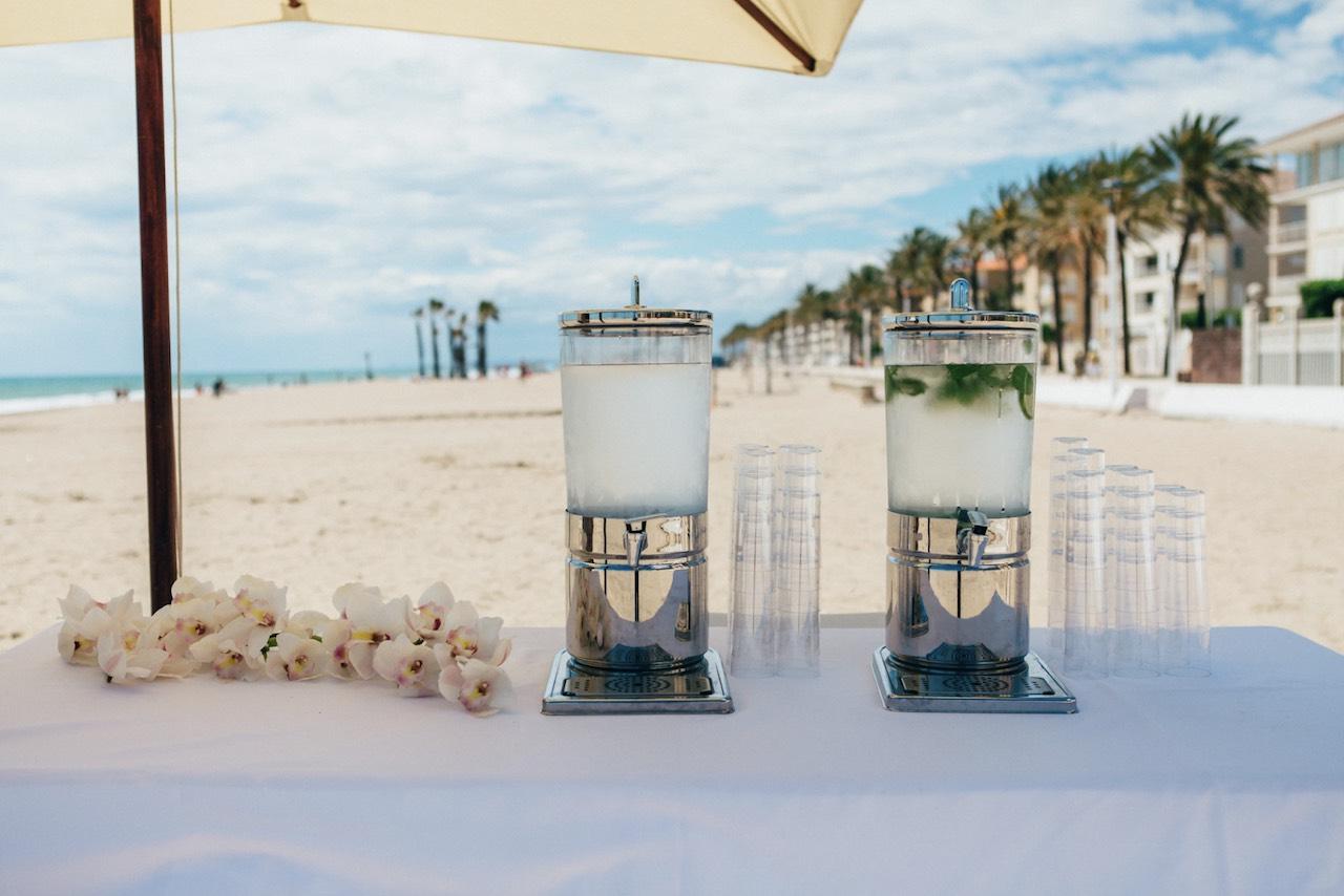 Drinks set up on a beach