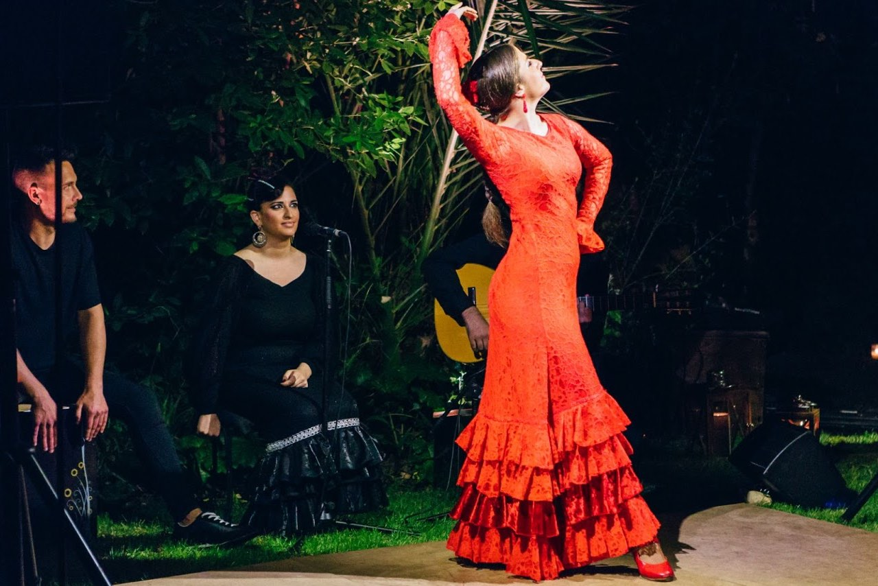 A Spanish dancer on stage outside