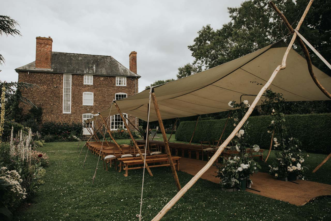 A tent set up for a wedding ceremony