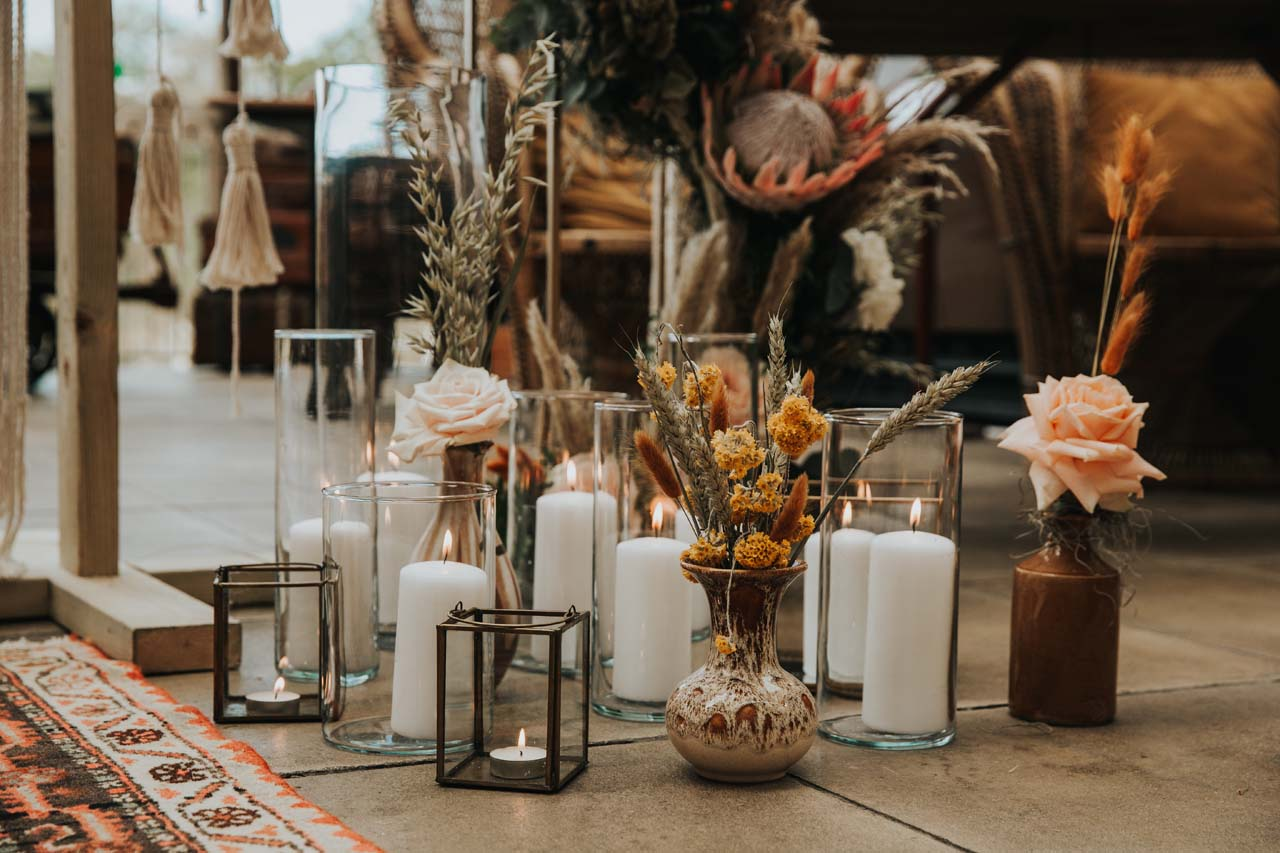 Dried flowers and candles on the floor