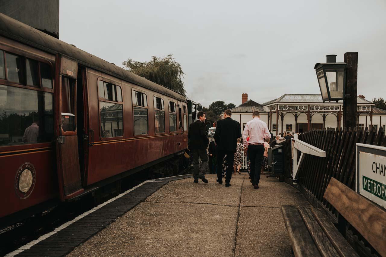Wedding guests on a train platform