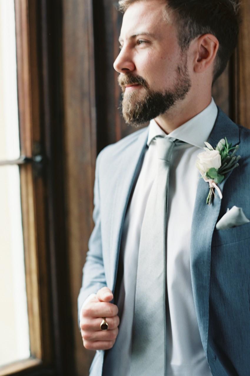 A man in a light blue suit